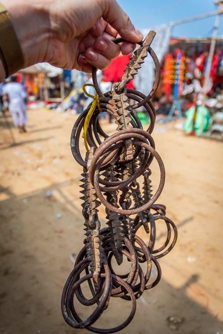 Illegal spiked bits for horses on sale at Pushkar camel fair in Rajasthan in India